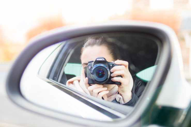 close up photography of woman taking a photo